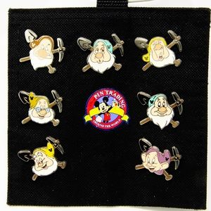 All Seven Dwarfs Disney trading pins.